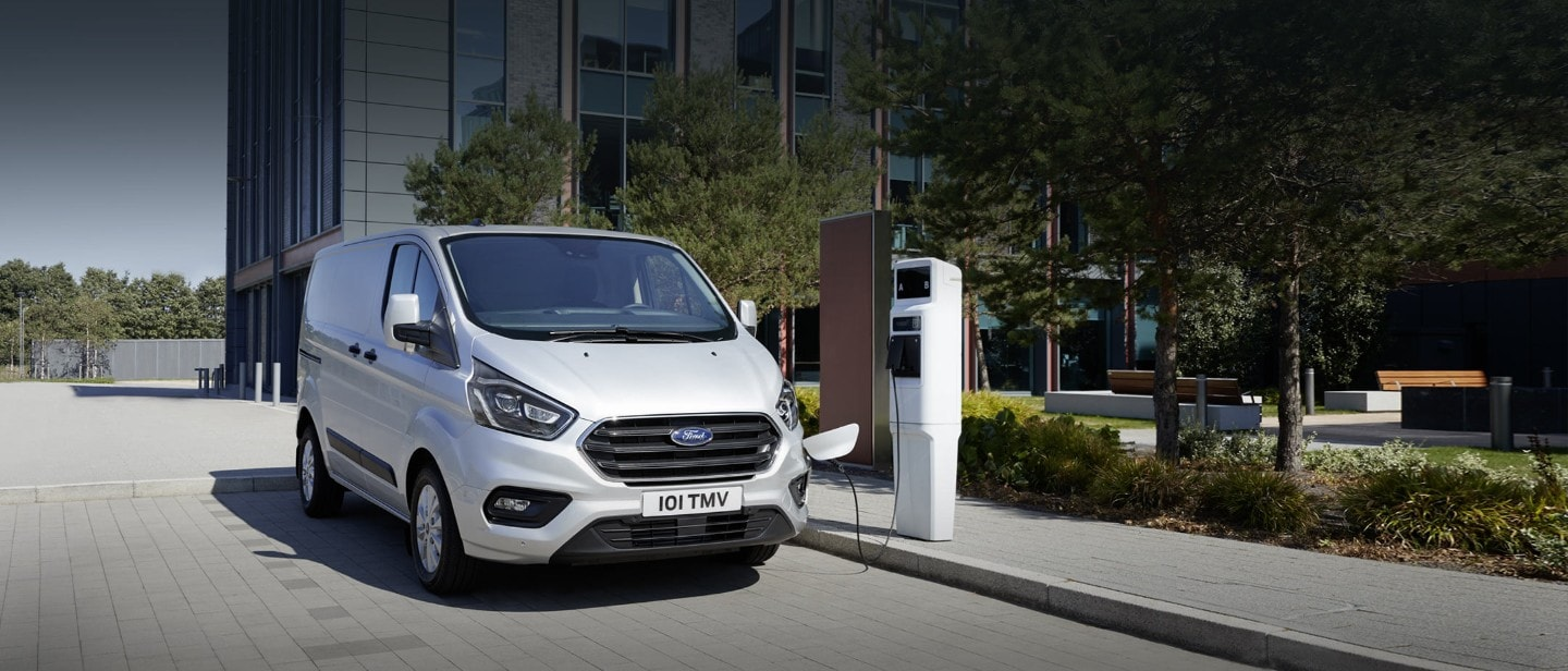 Ford Transit Custom charging at the charging point in city