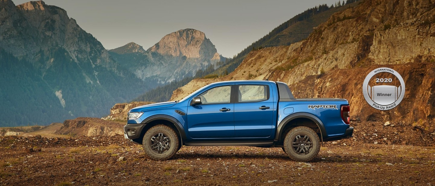 Blue Ford Ranger Raptor parked, profile view